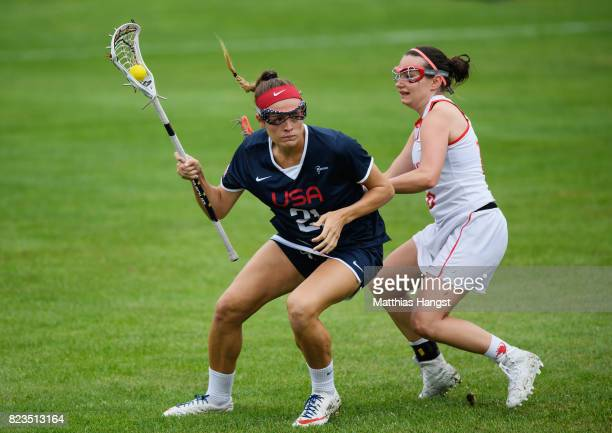 Taylor Cummings of the United States is challenged by Katarzyna Foryta of Poland during the Lacrosse Women's match between USA and Poland of The...