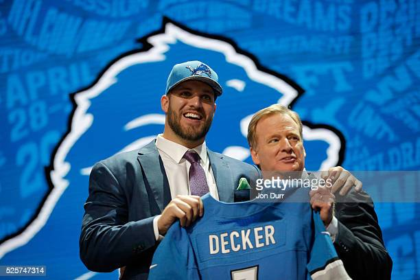 Taylor Decker of Ohio State holds up a jersey with NFL Commissioner Roger Goodell after being picked overall by the Detroit Lions during the first...
