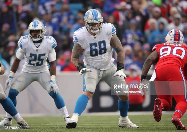 Taylor Decker of the Detroit Lions gets ready to block as Theo Riddick hangs in the backfield in the fourth quarter during NFL game against the...