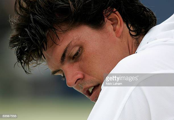 Taylor Dent pauses during his match against Lars Burgsmuller of Germany during the first round of US Open at the USTA National Tennis Center in...