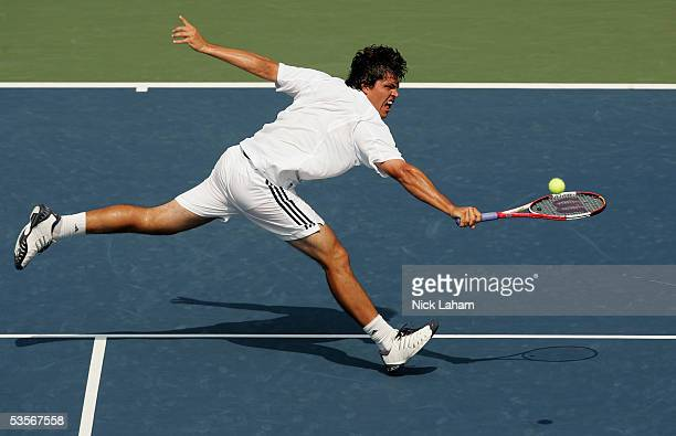 Taylor Dent reaches for a shot during his match against Lars Burgsmuller of Germany during the first round of US Open at the USTA National Tennis...