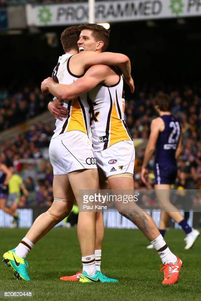 Taylor Duryea and Luke Breust of the Hawks celebrate a goal during the round 18 AFL match between the Fremantle Dockers and the Hawthorn Hawks at...