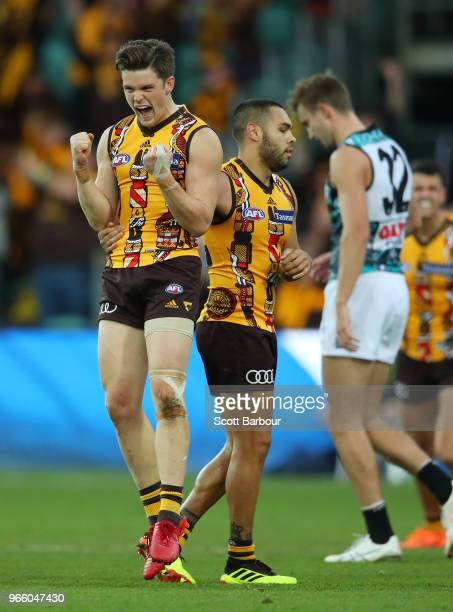 Taylor Duryea of the Hawks and Jarman Impey of the Hawks celebrate at the final siren during the round 11 AFL match between the Hawthorn Hawks and...