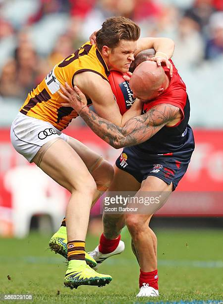 Taylor Duryea of the Hawks and Nathan Jones of the Demons compete for the ball during the round 20 AFL match between the Melbourne Demons and the...