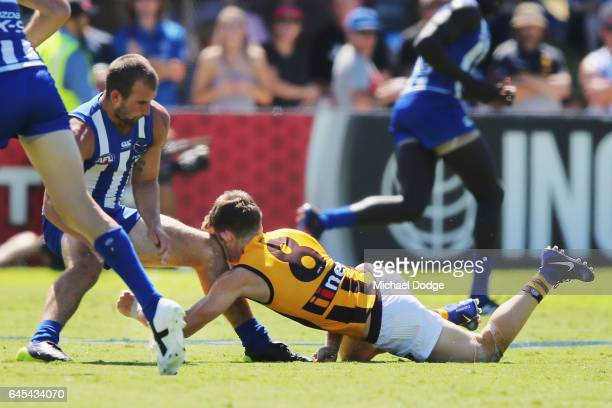Taylor Duryea of the Hawks receiving an accidental knee from Ben Cunnington of the Kangaroos during the JLT Community Series AFL match between the...