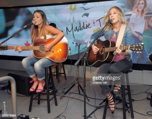Taylor Dye and Madison Marlow of Maddie Tae perform at Macy's at Macy's Herald Square on August 19 2017 in New York City