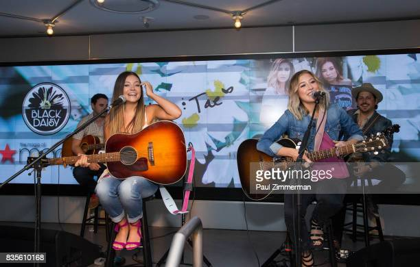 Taylor Dye and Madison Marlow of Maddie Tae perform at Macy's Herald Square on August 19 2017 in New York City