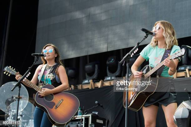 Taylor Dye and Madison Marlow of Maddie Tae performs during Faster Horses Festival at Michigan International Speedway on July 21 2017 in Brooklyn...