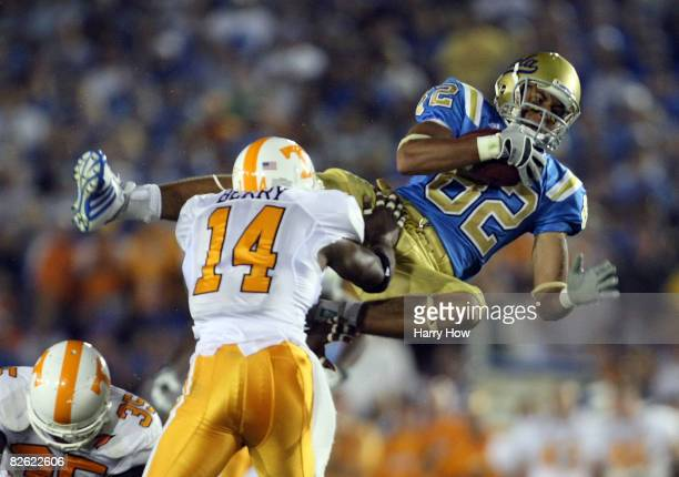 Taylor Embree of the UCLA Bruins makes a catch for a first down in front of Eric Berry of the Tennessee Volunteers during the fourth quarter at the...