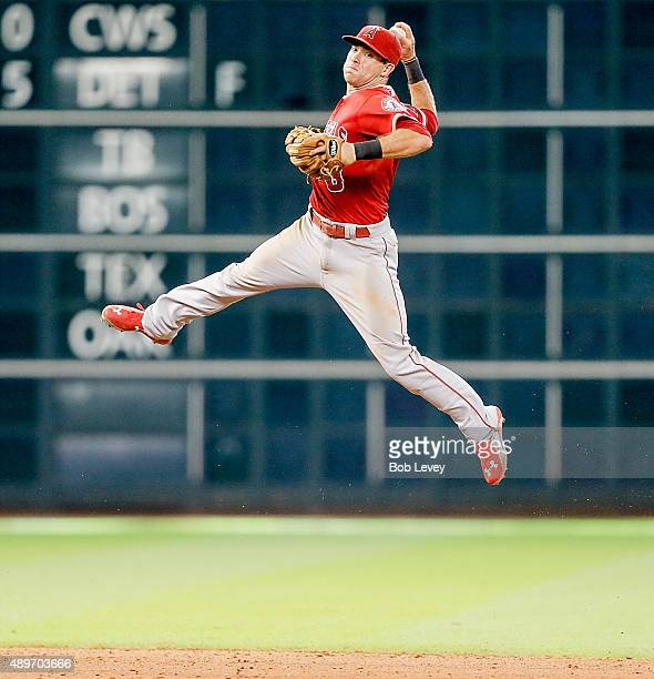 Taylor Featherston of the Los Angeles Angels of Anaheim attempts to throw out Matt Duffy of the Houston Astros in the seventh inning at Minute Maid...