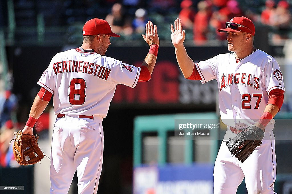 Taylor Fetherston #8 of the Los Angeles Angels of Anaheim celebrates with Mike Trout #27 after defeating the Texas Rangers at Angel Stadium of Anaheim on July 26, 2015 in Anaheim, California. The Angels beat the Rangers 7-13.