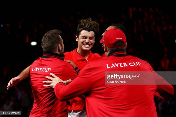 Taylor Fritz of Team World celebrates match point with teammates in his singles match against Dominic Thiem of Team Europe during Day Three of the...
