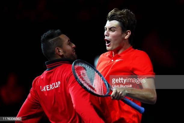 Taylor Fritz of Team World celebrates winning the first set with teammate Nick Kyrgios in his singles match against Dominic Thiem of Team Europe...