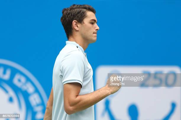 Taylor Fritz of the United States celebrates a shot during the match against Marco Chiudinelli of Switzerland during Qualifying second round of 2017...