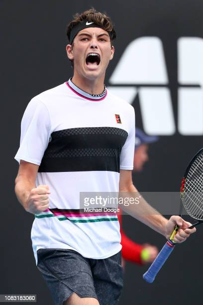 Taylor Fritz of the United States celebrates in his second round match against Gael Monfils of France during day three of the 2019 Australian Open at...
