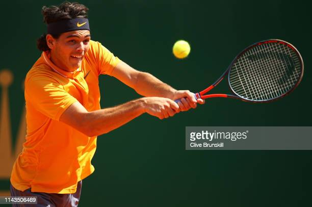 Taylor Fritz of the United States plays a back hand against Novak Djokovic of Serbia in their third round match during day five of the Rolex...