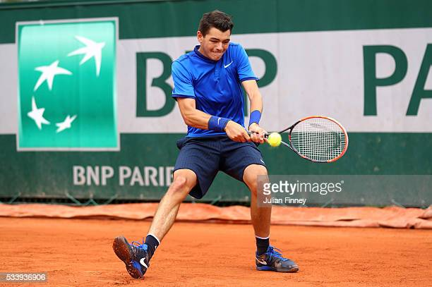 Taylor Fritz of the United States plays a backhand during the Men's Singles first round match against Borna Coric of Croatia on day three of the 2016...