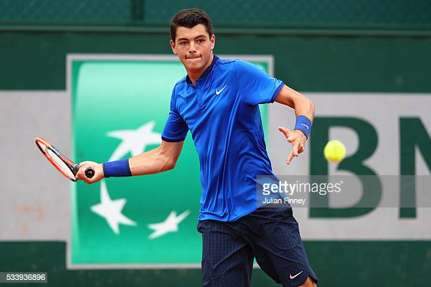Taylor Fritz of the United States plays a forehand during the Men's Singles first round match against Borna Coric of Croatia on day three of the 2016...