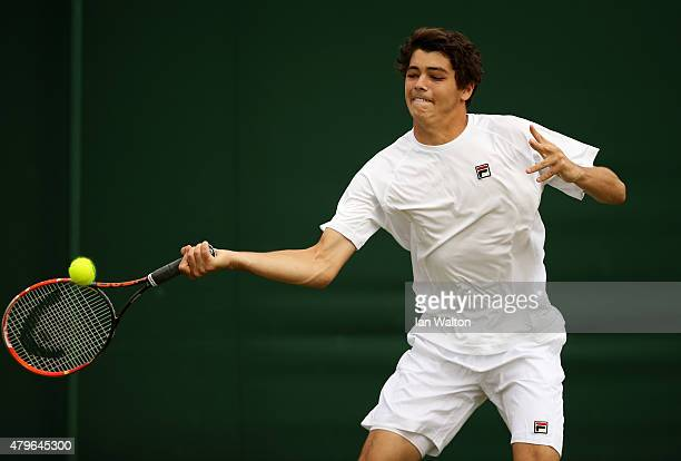 Taylor Fritz of the United States plays a forehand in his Boy's Singles First Round match against Jay Clarke of Great Britain during day seven of the...