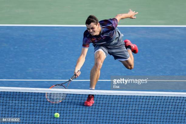 Taylor Fritz of the United States returns a shot against Dominic Thiem of Austria during their second round Men's Singles match on Day Four of the...