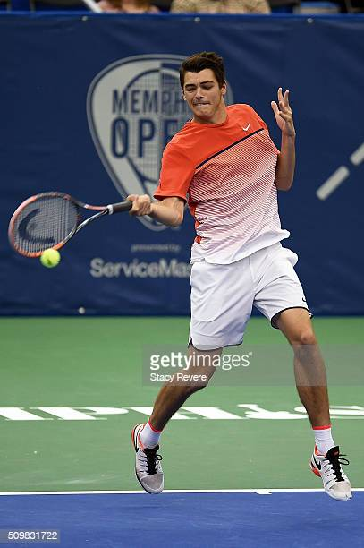 Taylor Fritz of the United States returns a shot to Benjamin Becker of Germany during their quarterfinal singles match on Day 5 of the Memphis Open...
