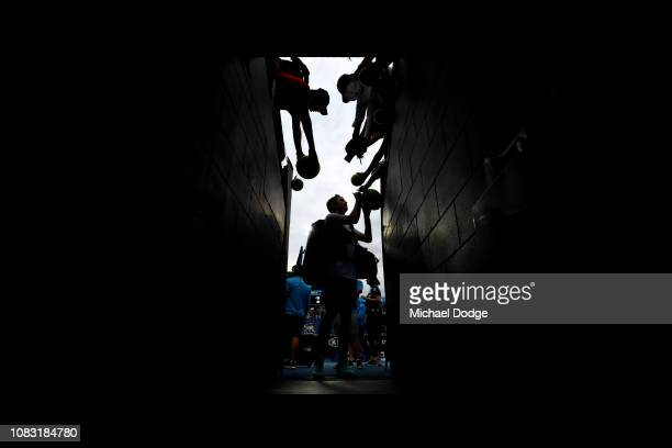 Taylor Fritz of the United States signs autographs after winning his second round match against Gael Monfils of France during day three of the 2019...