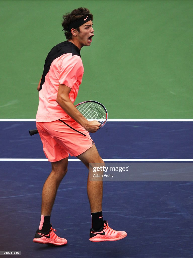 Taylor Fritz of the USA celebrates victory after his match against Andrey Rublev of Russia during the BNP Paribas Open at the Indian Wells Tennis Garden on March 10, 2018 in Indian Wells, California.