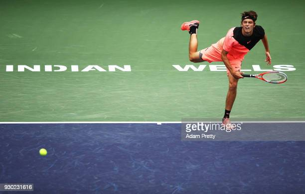 Taylor Fritz of the USA serves during his match against Andrey Rublev of Russia during the BNP Paribas Open at the Indian Wells Tennis Garden on...