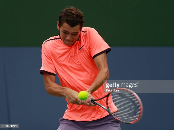 Taylor Fritz of United States returns a shot to Andrea Seppi of Italy at a Qualifying match of ATP Shanghai Rolex Masters 2016 at Qi Zhong Tennis...
