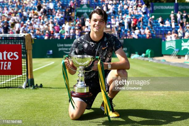 Taylor Fritz of USA celebrates with the cup after winning the men's singles final against Sam Querrey of USA during day six of the Nature Valley...