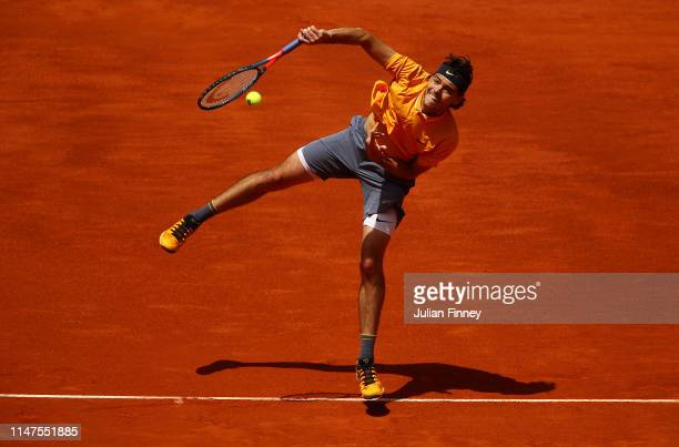 Taylor Fritz of USA in action against Novak Djokovic of Serbia during day four of the Mutua Madrid Open at La Caja Magica on May 07 2019 in Madrid...