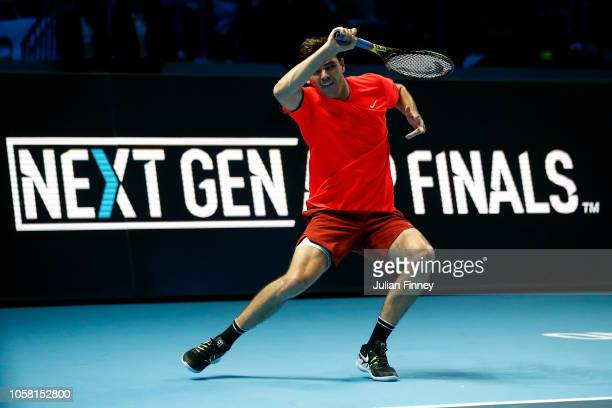 Taylor Fritz of USA in action in his match against Andrey Rublev of Russia in the group stages during Day One of the Next Gen ATP Finals at Fiera...
