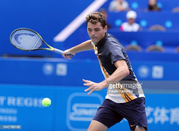Taylor Fritz of USA returns a hit against Fabio Fognini of Italy in the ATP 250 Chengdu Open in Chengdu in southwest China's Sichuan province...