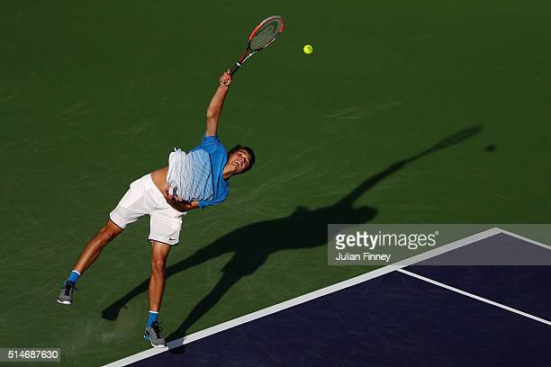 Taylor Fritz of USA serves to Frances Tiafoe of USA during day four of the BNP Paribas Open at Indian Wells Tennis Garden on March 10, 2016 in Indian...
