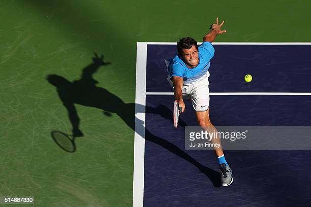 Taylor Fritz of USA stretches for a forehand against Frances Tiafoe of USA during day four of the BNP Paribas Open at Indian Wells Tennis Garden on...