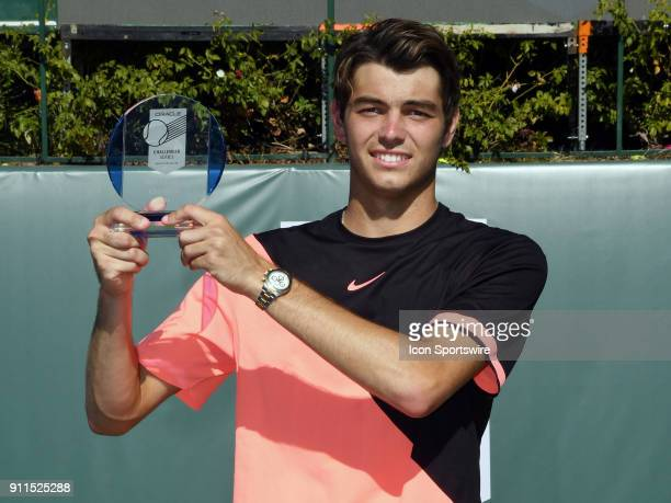 Taylor Fritz stands with the men's championship trophy after defeating Bradley Klahn in three sets of the finals of the Oracle Challenger Series...