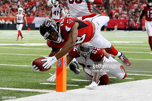 Taylor Gabriel of the Atlanta Falcons dives for the pylon past Tony Jefferson of the Arizona Cardinals to score a touchdown during the second half at...