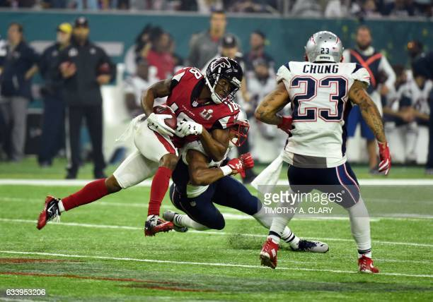 TOPSHOT Taylor Gabriel of the Atlanta Falcons makes a run against Eric Rowe of the New England Patriots during the third quarter of the Super Bowl 51...