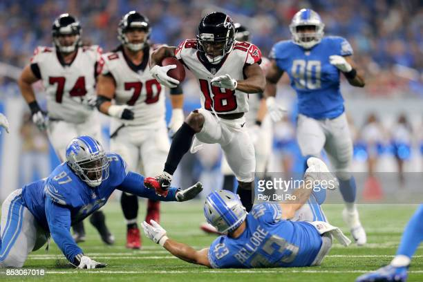 Taylor Gabriel of the Atlanta Falcons runs over Armonty Bryant of the Detroit Lions and Nick Bellore during the first quarter action at Ford Field on...