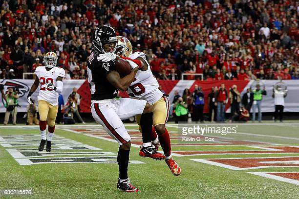 Taylor Gabriel of the Atlanta Falcons scores a touchdown against Tramaine Brock of the San Francisco 49ers during the first half at the Georgia Dome...