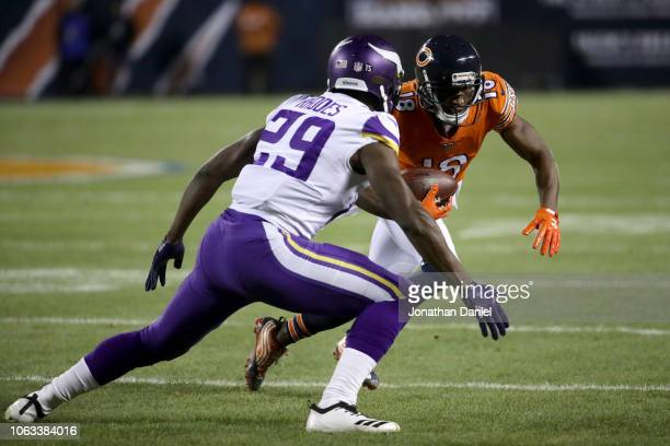 Taylor Gabriel of the Chicago Bears carries the football against Xavier Rhodes of the Minnesota Vikings in the first quarter at Soldier Field on...