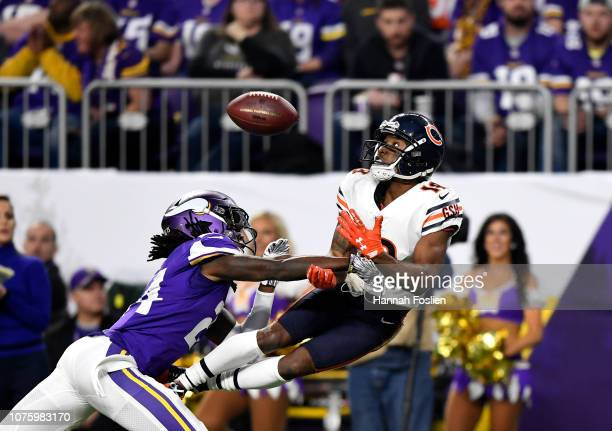 Taylor Gabriel of the Chicago Bears catches the ball over defender Holton Hill of the Minnesota Vikings in the second quarter of the game at US Bank...