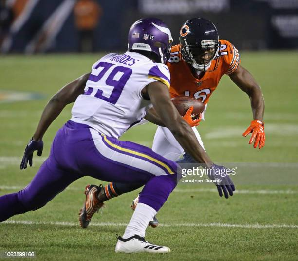 Taylor Gabriel of the Chicago Bears moves against Xavier Rhodes of the Minnesota Vikings after a catch at Soldier Field on November 18 2018 in...