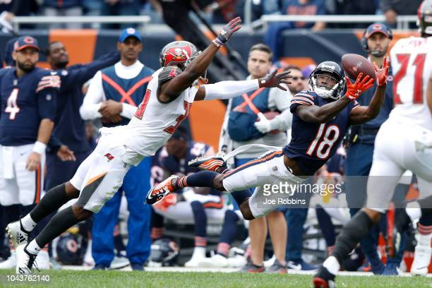 Taylor Gabriel of the Chicago Bears receives the pass in the second quarter against the Tampa Bay Buccaneers at Soldier Field on September 30 2018 in...