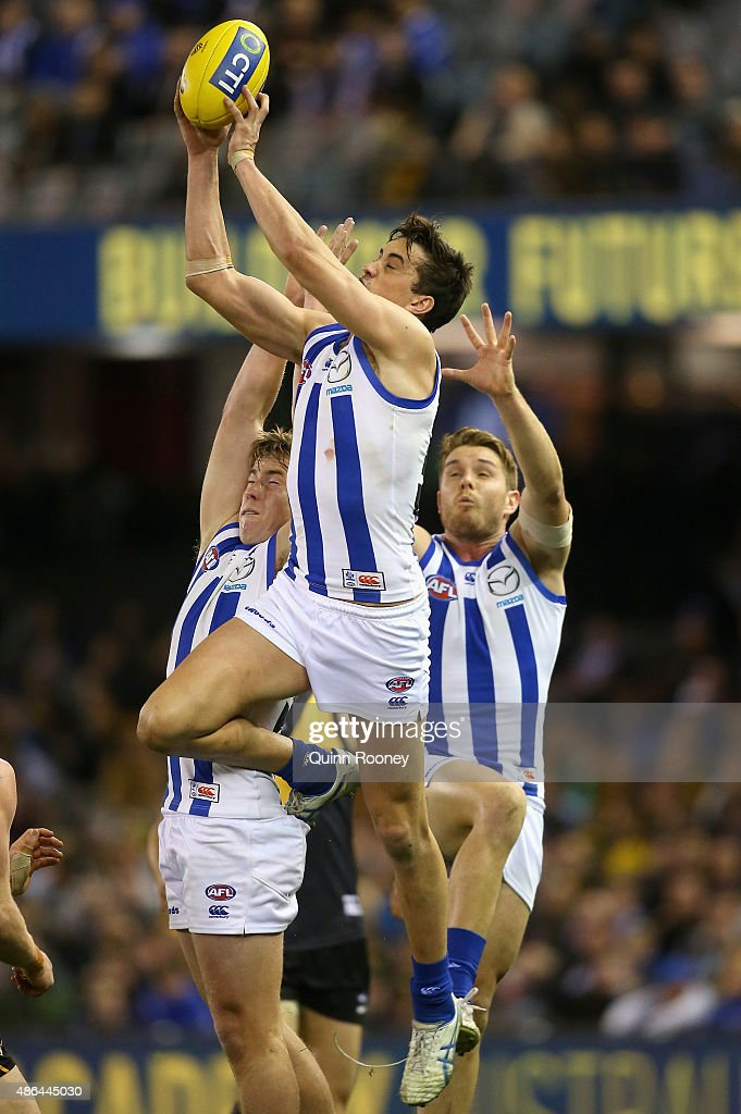 Taylor Garner of the Kangaroos marks during the round 23 AFL match between the Richmond Tigers and the North Melbourne Kangaroos at Etihad Stadium on September 4, 2015 in Melbourne, Australia.