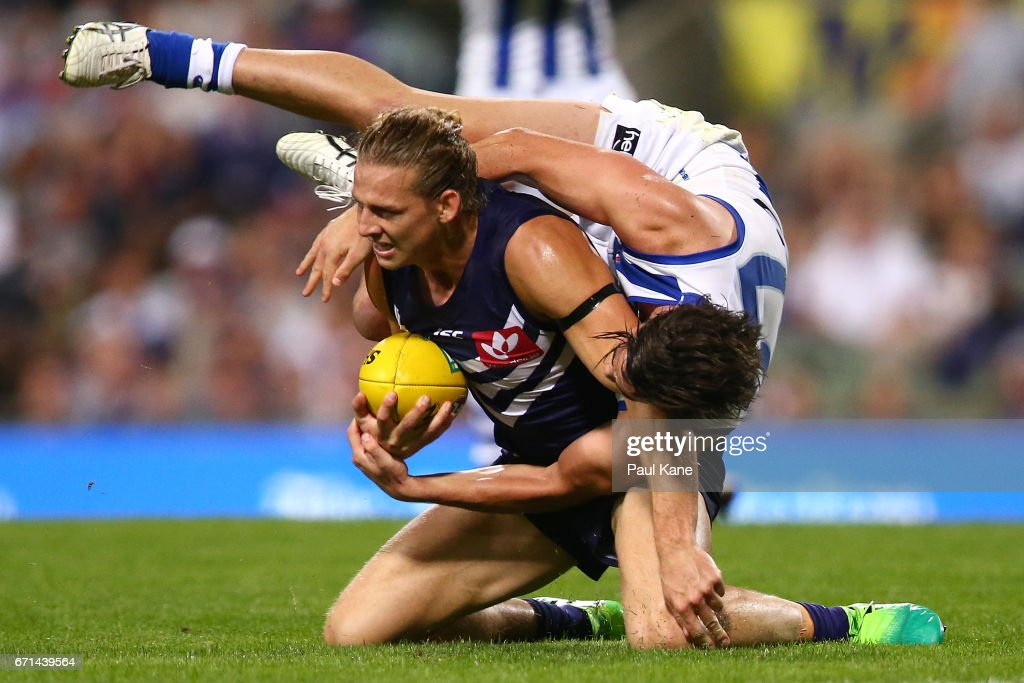 Taylor Garner of the Kangaroos tackles Nathan Fyfe of the Dockers during the round five AFL match between the Fremantle Dockers and the North Melbourne Kangaroos at Domain Stadium on April 22, 2017 in Perth, Australia.