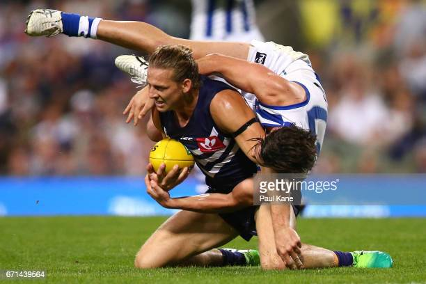 Taylor Garner of the Kangaroos tackles Nathan Fyfe of the Dockers during the round five AFL match between the Fremantle Dockers and the North...