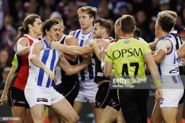 Taylor Garner of the Kangaroos wrestles with Maverick Weller of the Saints during the round 22 AFL match between the St Kilda Saints and the North...