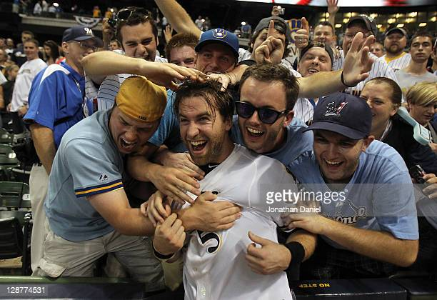 Taylor Green of the Milwaukee Brewers celebrates with the fans after the Brewers 3-2 10 inning victory against the Arizona Diamondbacks in Game Five...