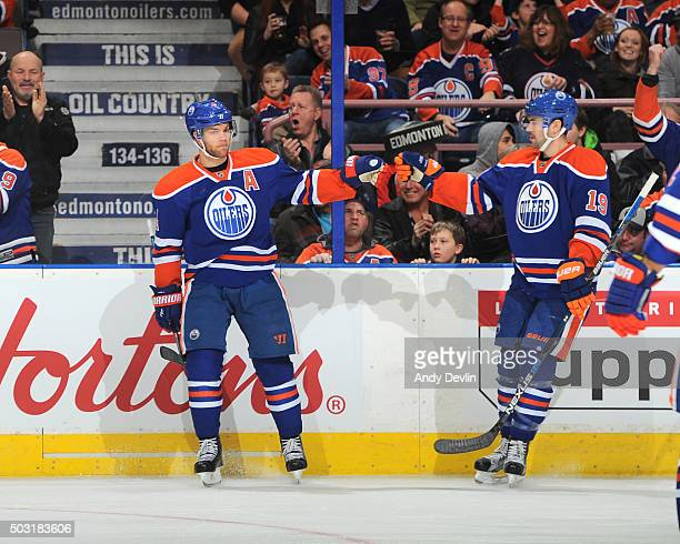 Taylor Hall and Justin Schultz of the Edmonton Oilers celebrate after a goal during the game against the Arizona Coyotes on January 2 2016 at Rexall...